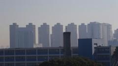 Detalhe de névoa de poluição e ao fundo vista de alguns prédios da Cidade de São Paulo. Foto: Marcos Santos/USP Imagens