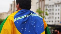 Manifestante com bandeira do Brasil greve geral 2017 – George Campos / USP Imagens
